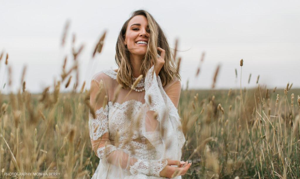 Bride posing in grass